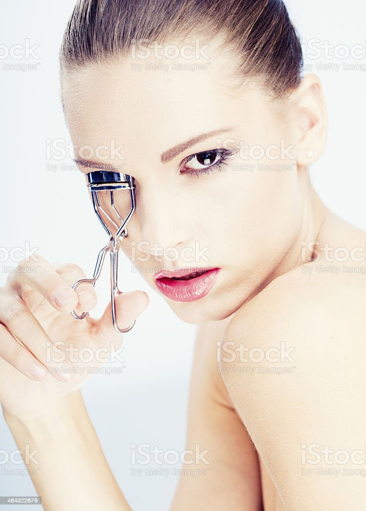 girl with Eyelash Curler stock photo