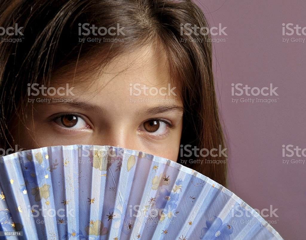 Girl with fan royalty-free stock photo