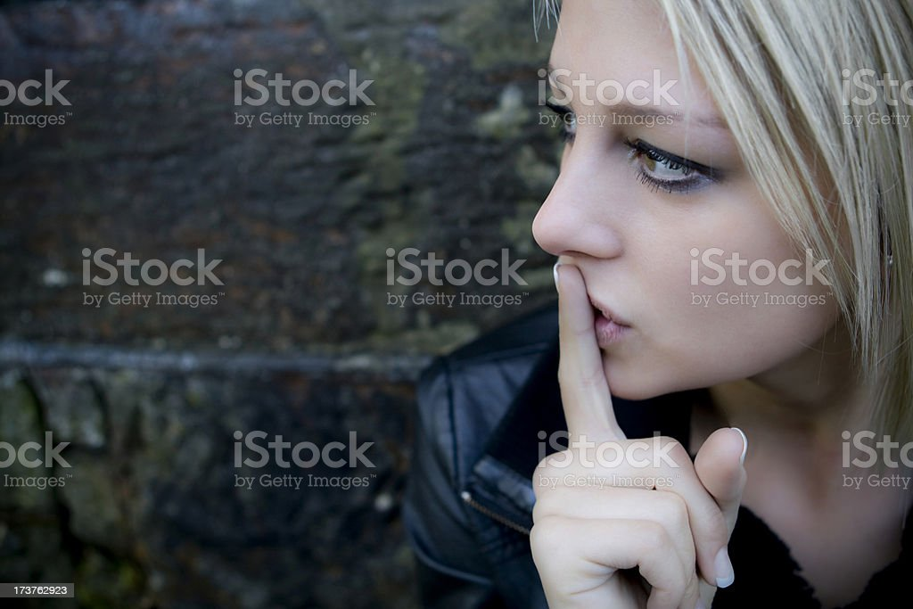 Girl with finger on lips - be quiet. royalty-free stock photo