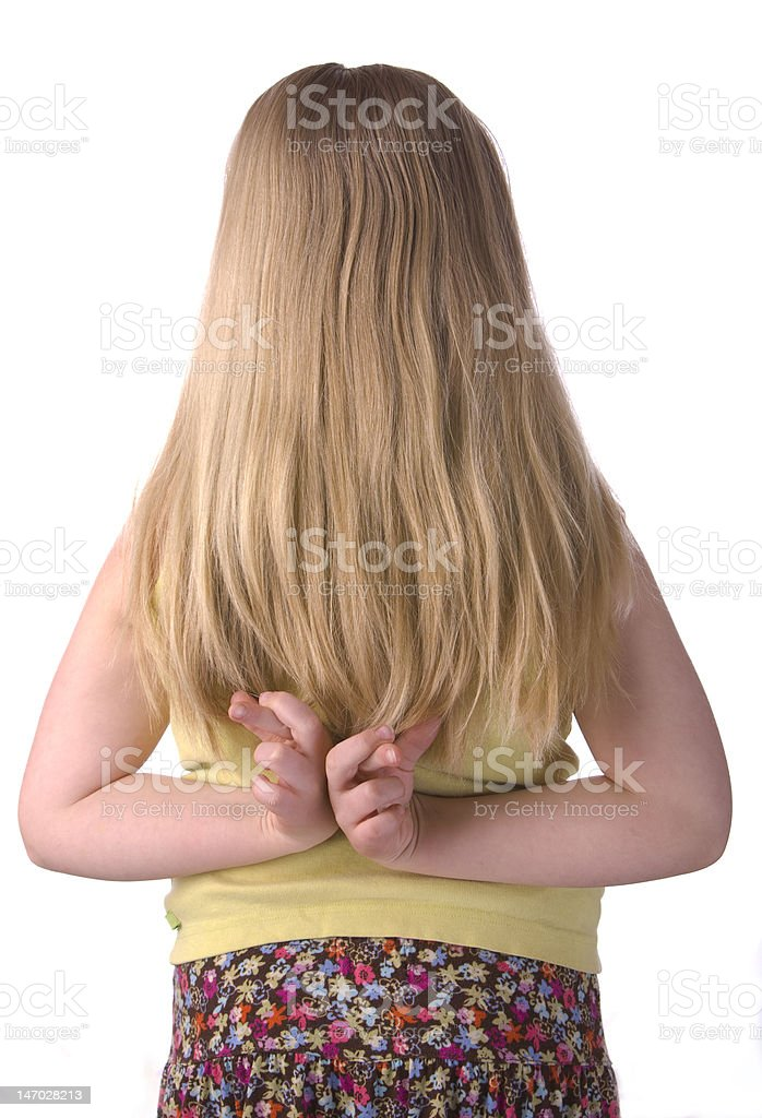 Girl With Fingers Crossed Behind Back stock photo