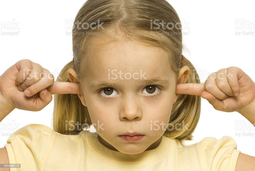 Girl with fingers in ears, not listening stock photo