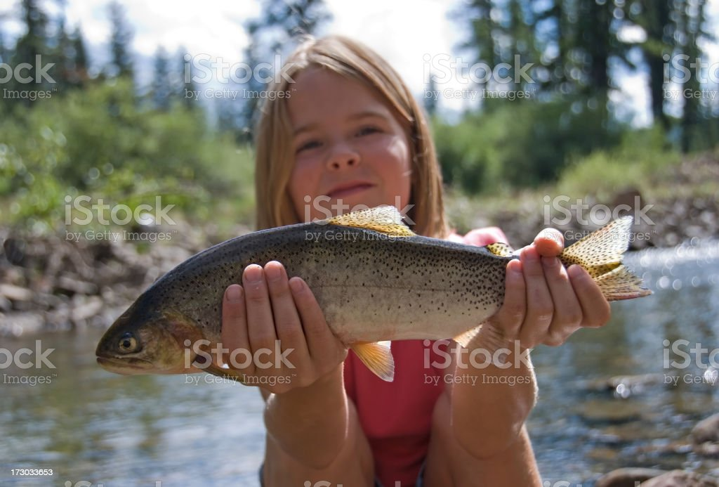 Girl With Fish royalty-free stock photo