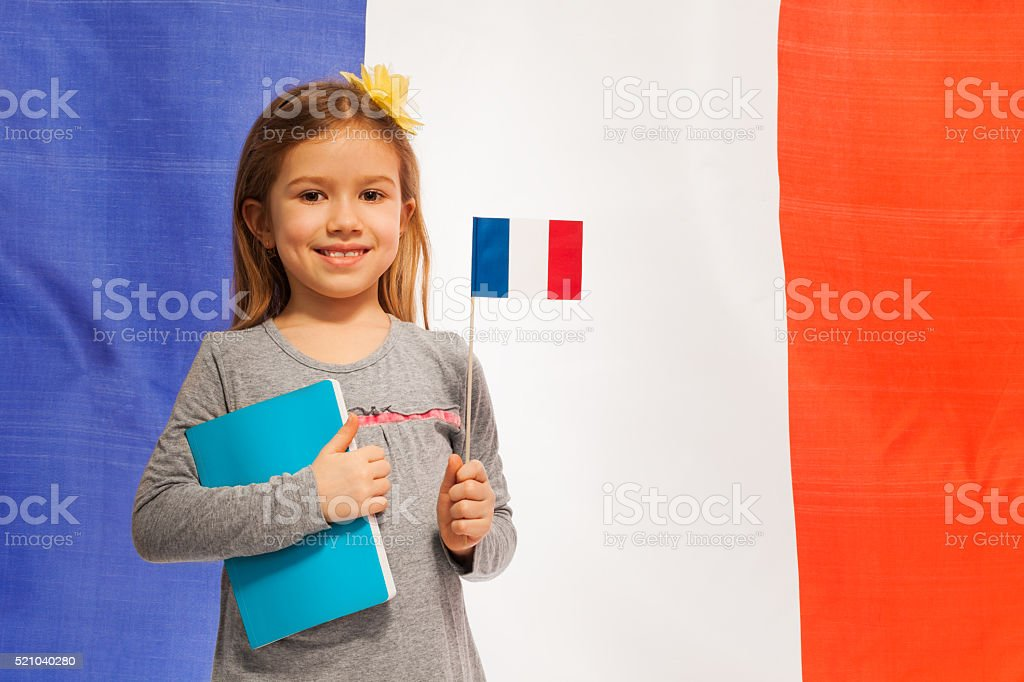 Girl with flag and book against French banner stock photo