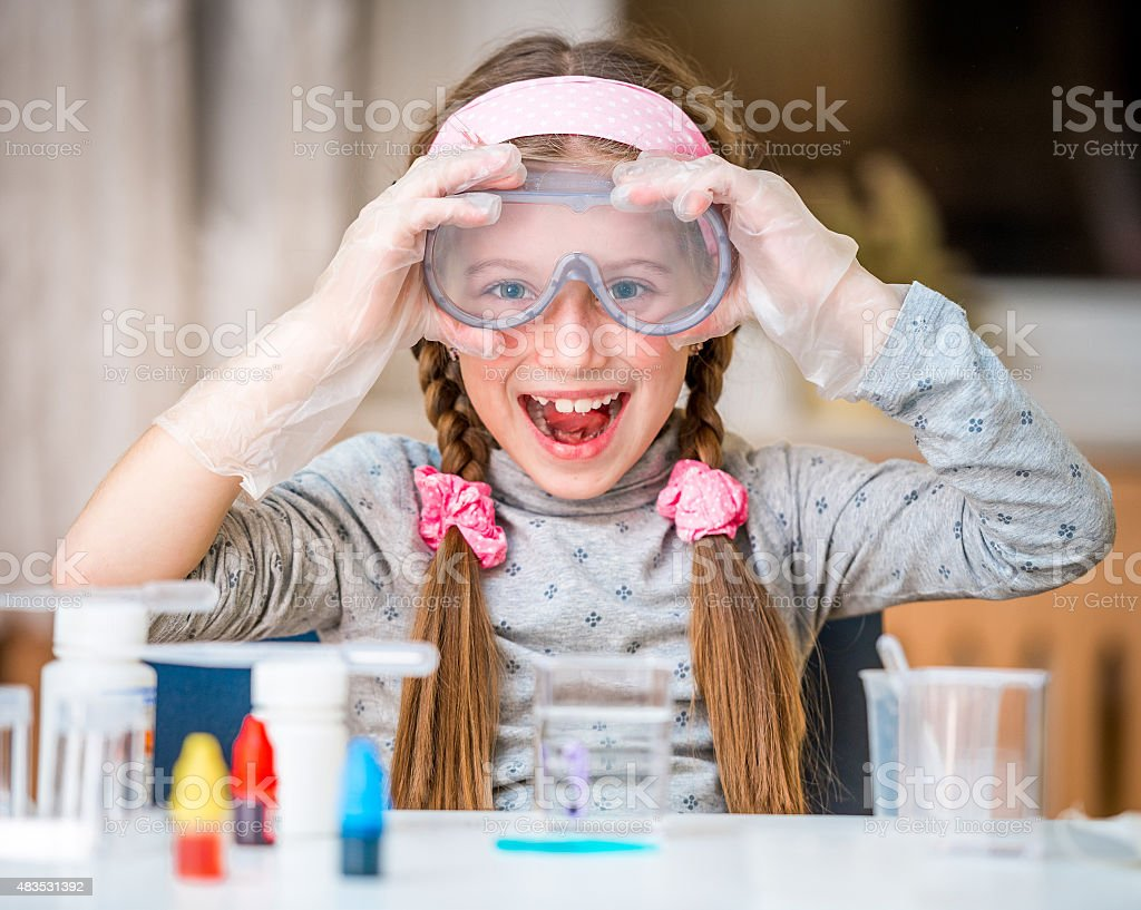 girl with flasks for chemistry stock photo