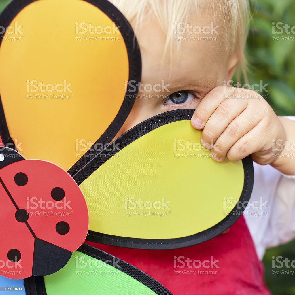 Girl with flower toy royalty-free stock photo