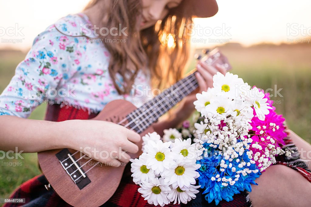 Girl with flowers and ukulele stock photo