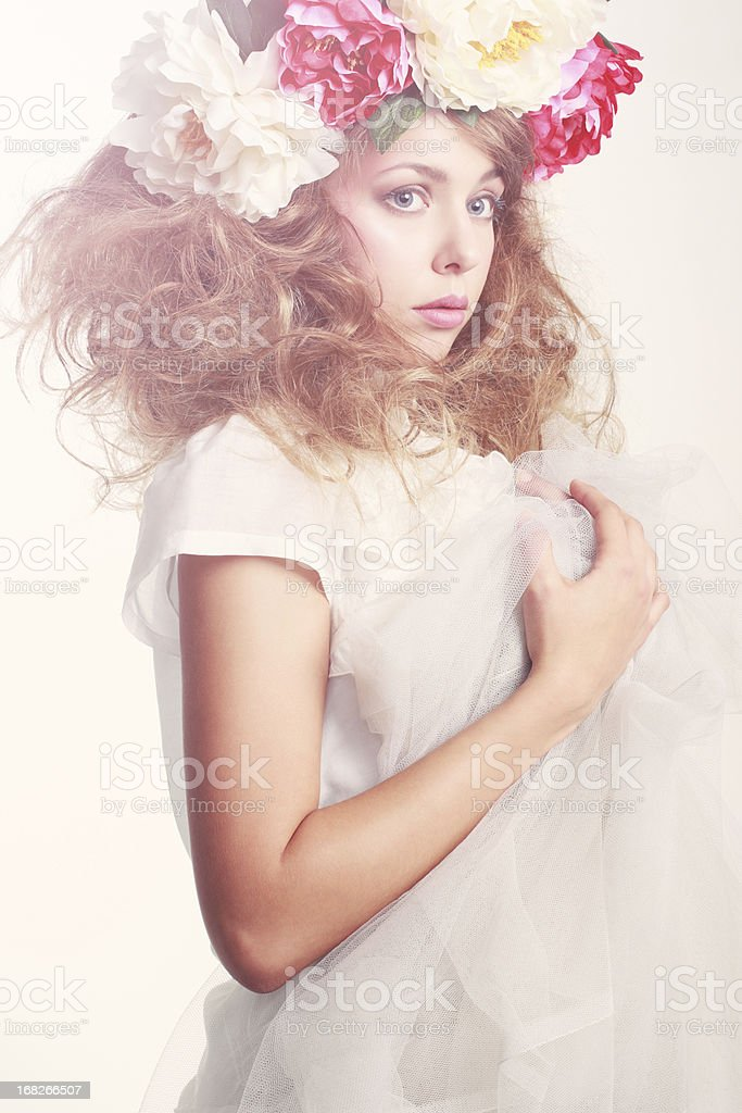 Girl with flowers in her hair royalty-free stock photo