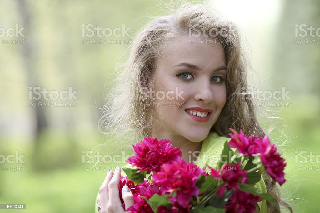 Girl with flowers in nature royalty-free stock photo