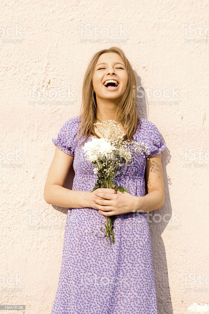 Girl with flowers standing outdoor royalty-free stock photo