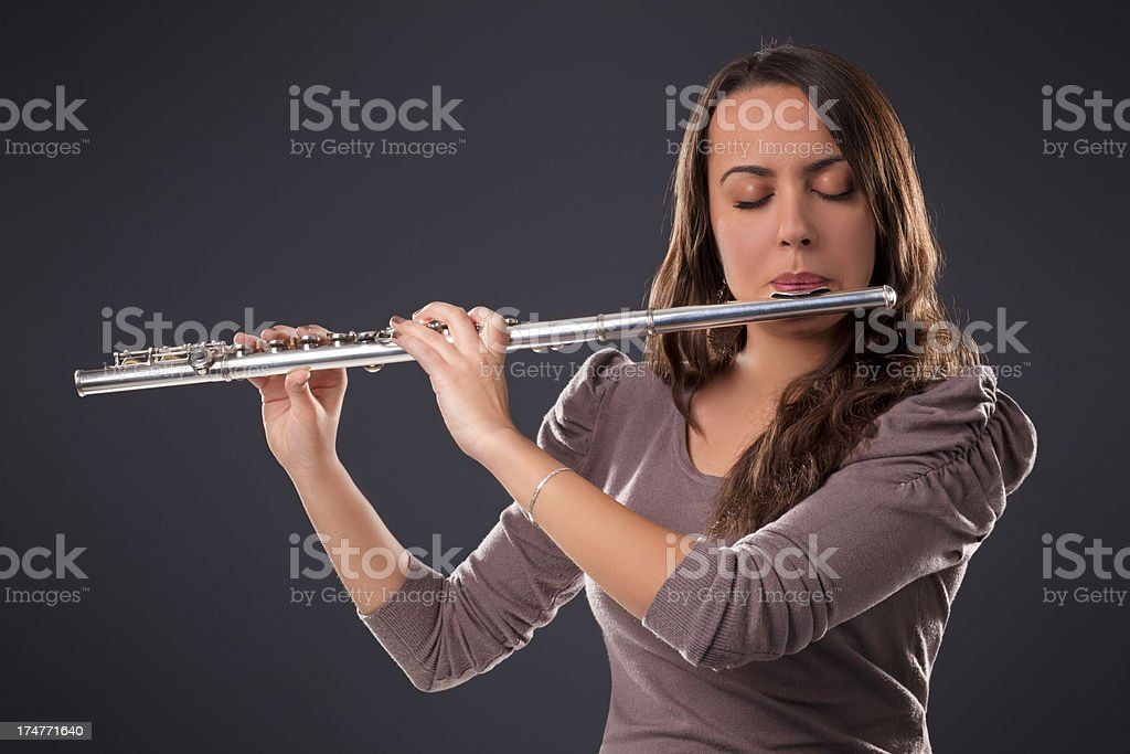 Girl with flute royalty-free stock photo