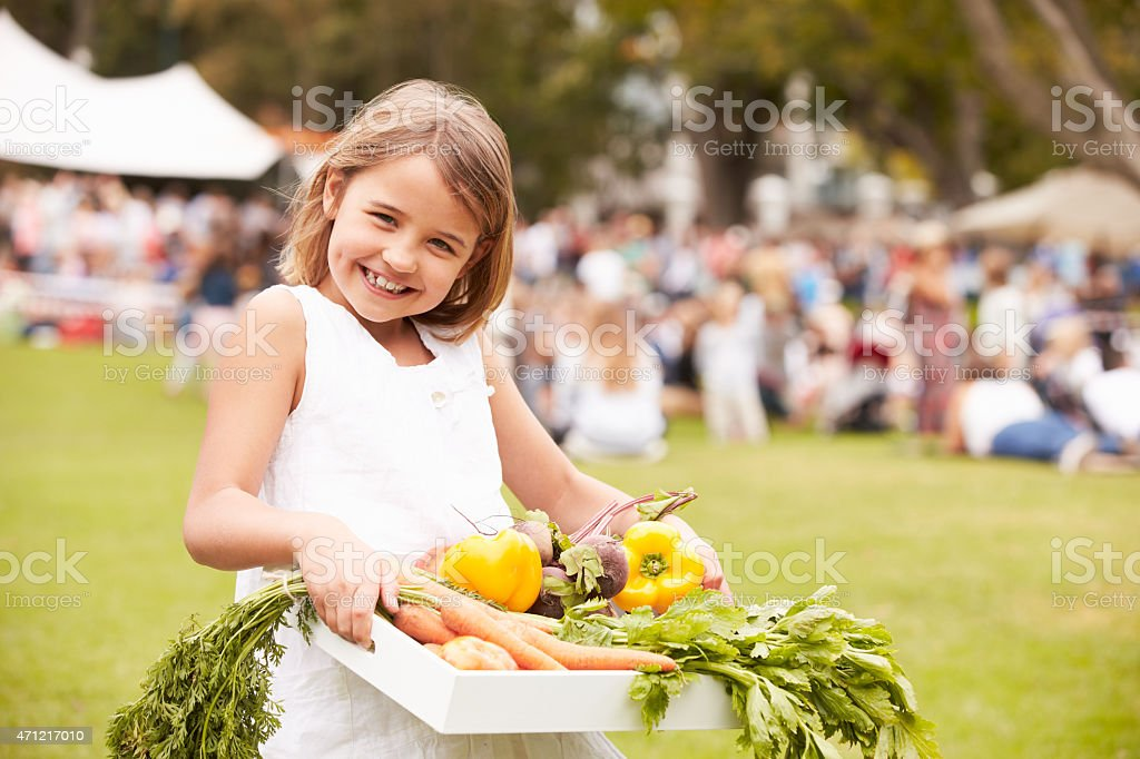Girl With Fresh Produce Bought At Outdoor Farmers Market stock photo