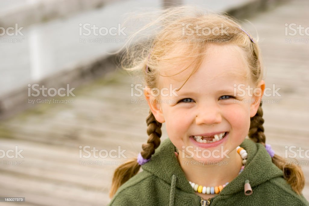 Girl with funny tooth gap stock photo