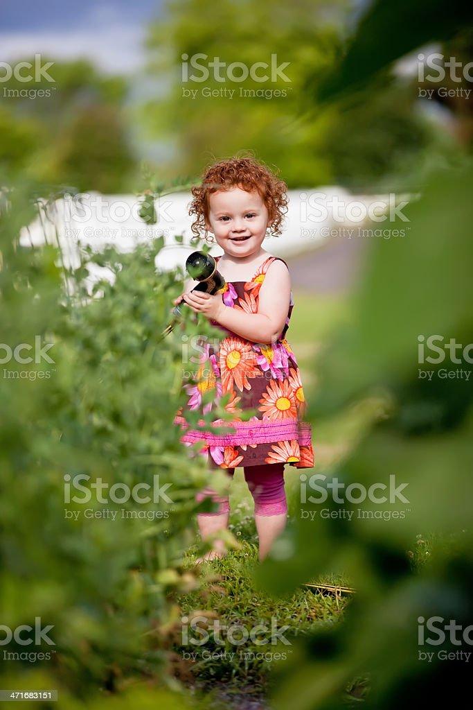 Girl With Garden Hose royalty-free stock photo