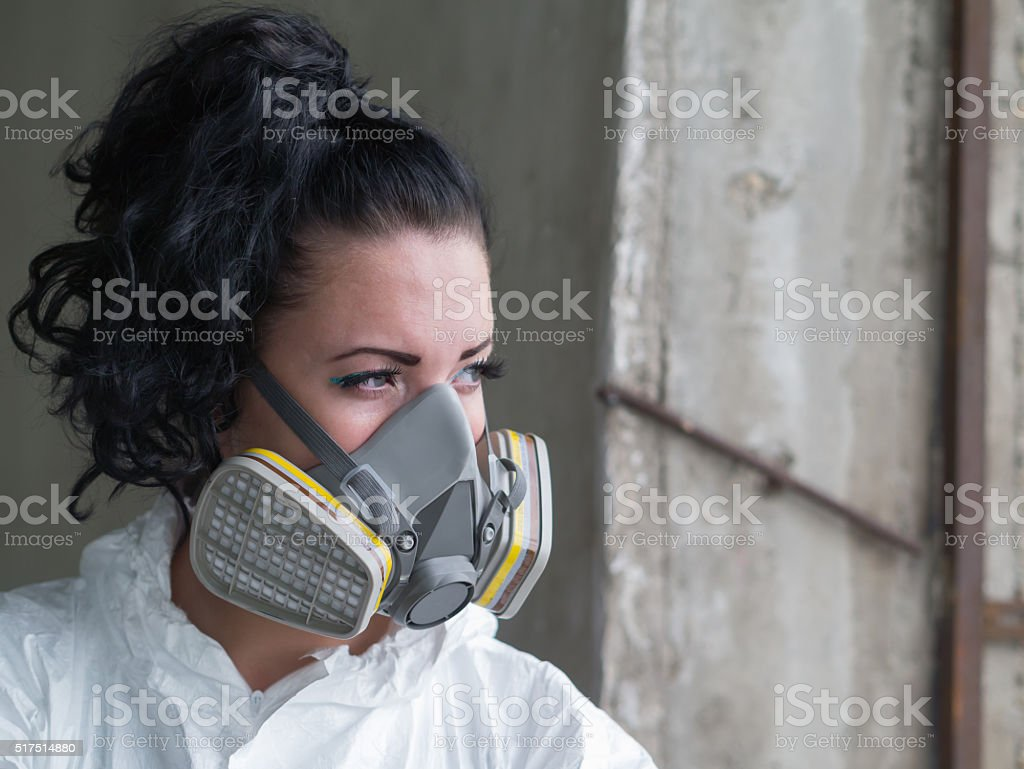 girl with gas mask stock photo