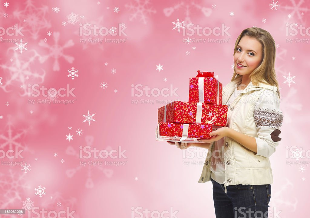 Girl with gift boxes on winter background royalty-free stock photo