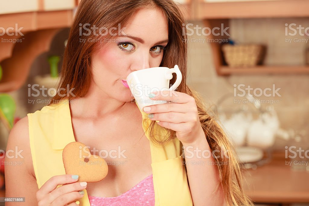 Girl with gingerbread cookies drinking tea coffee. stock photo