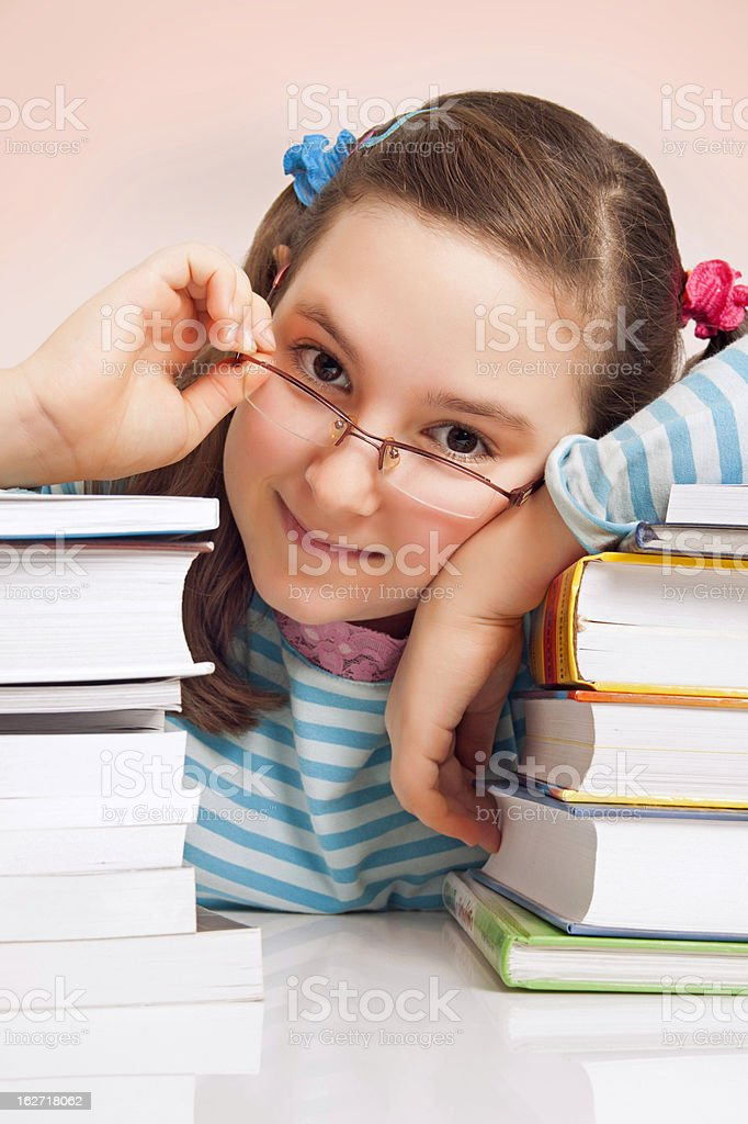 Girl with glasses and a lot of books royalty-free stock photo