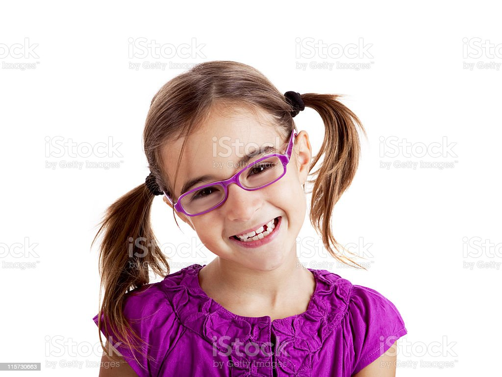 Girl with glasses and pigtails smiling at the camera royalty-free stock photo
