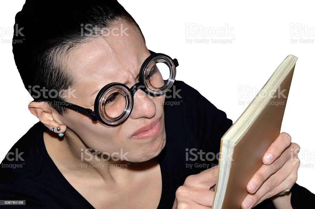 girl with glasses reading a book stock photo