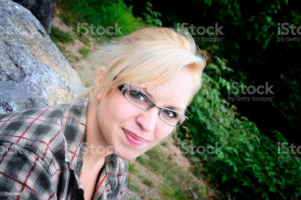 Girl with Glasses Smiles at Camera stock photo