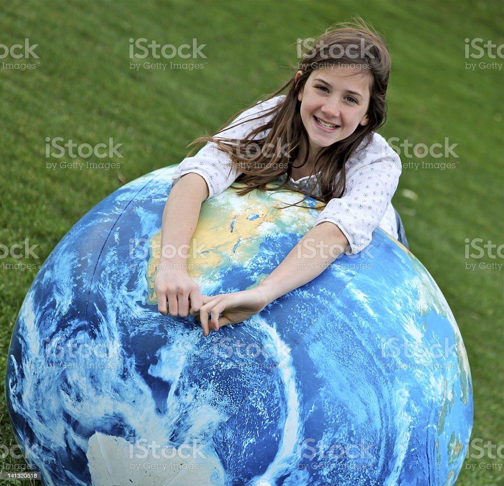 Girl with globe celebrates Earth Day royalty-free stock photo