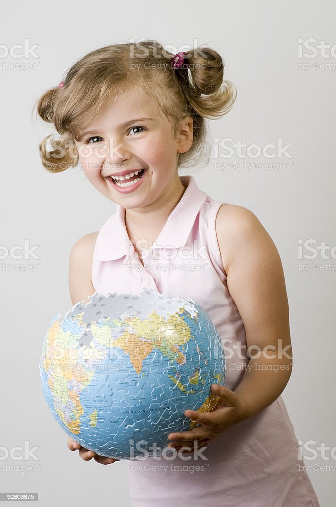 Girl with globe puzzle royalty-free stock photo
