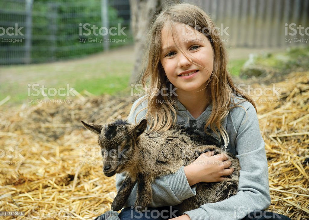 Girl with goatling stock photo