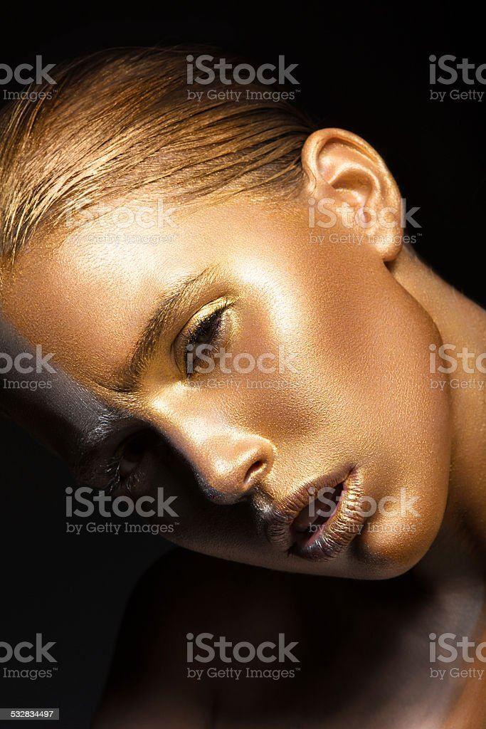 Girl with gold and silver skin stock photo