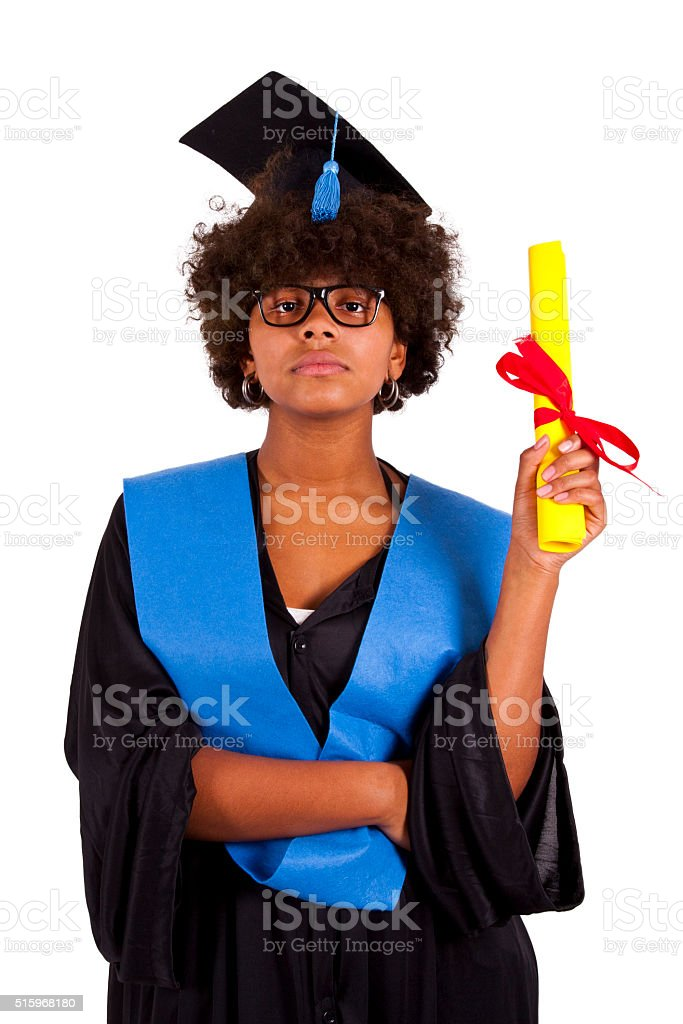 girl with graduation gown stock photo
