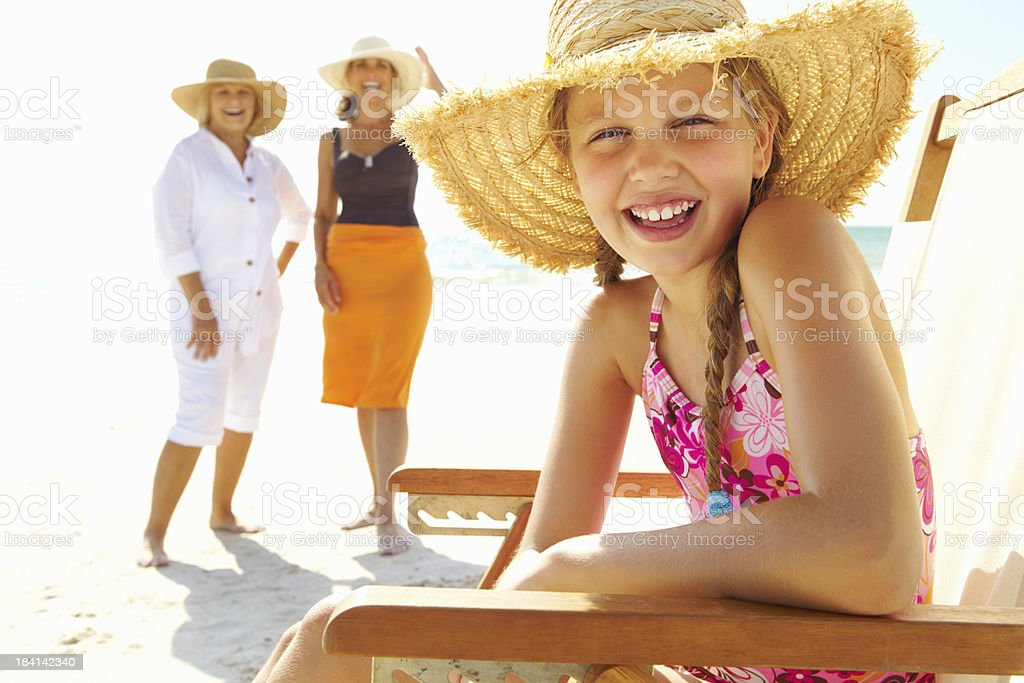 Girl with grandmother and mother enjoying on the beach stock photo