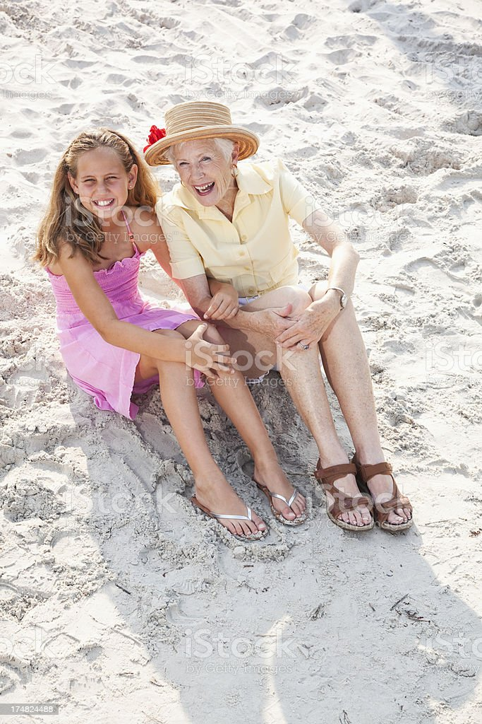 Girl with grandmother at the beach royalty-free stock photo