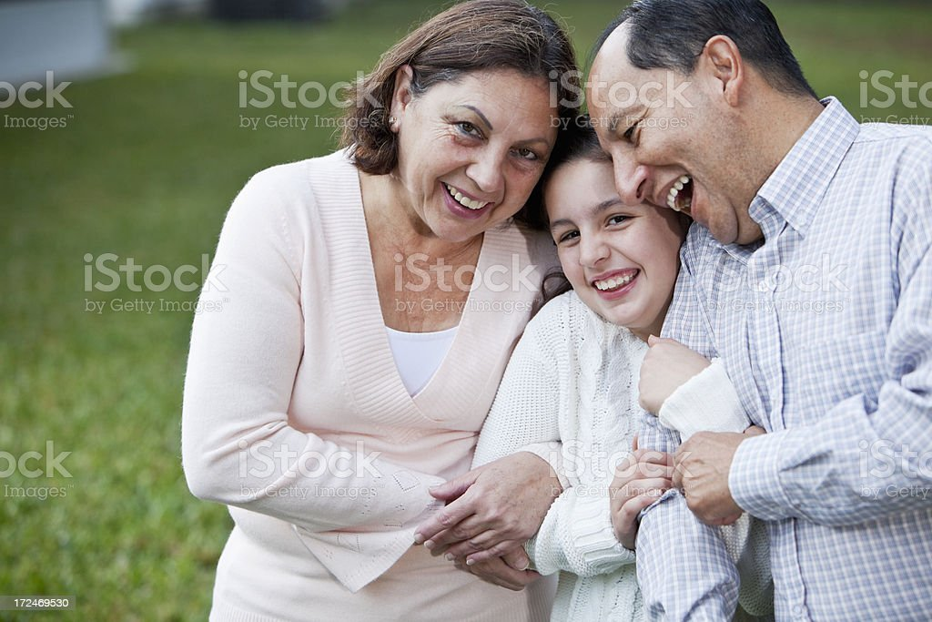 Girl with grandparents stock photo