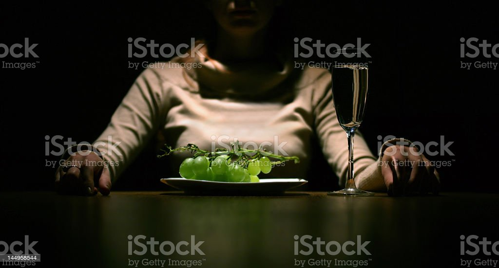 girl with grape royalty-free stock photo