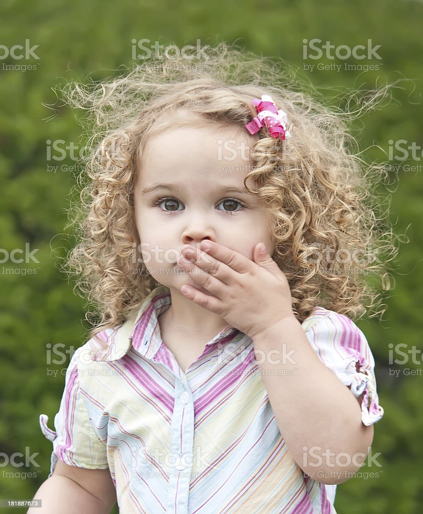 Girl With Hand Covering Mouth royalty-free stock photo