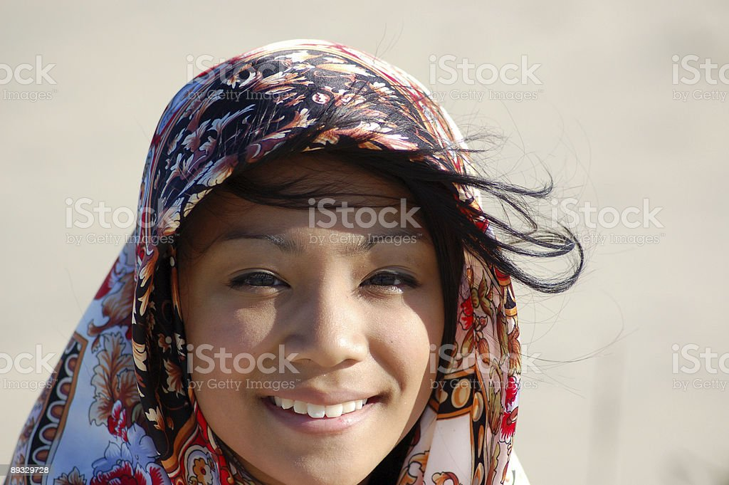 Girl with Head Scarf stock photo