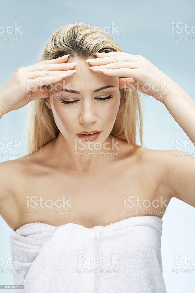 Girl with headache royalty-free stock photo