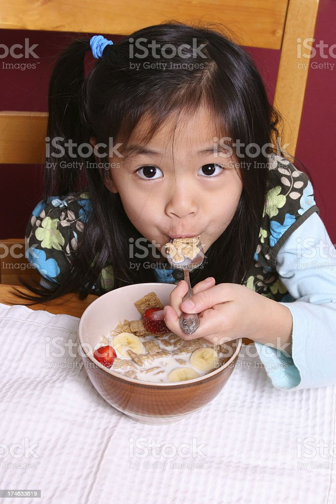 Girl with healthy bowl of cereal royalty-free stock photo