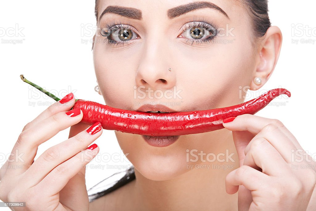 Girl with heart in mouth stock photo
