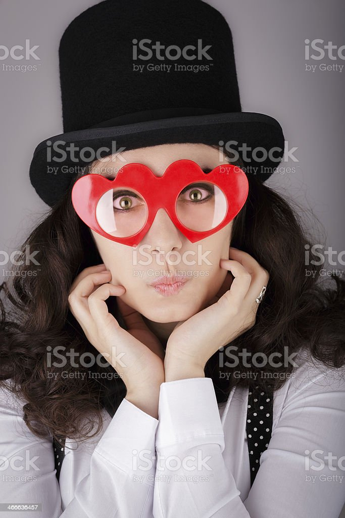 Girl with Heart-Shaped Glasses and Top Hat royalty-free stock photo