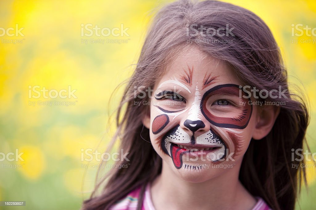 Girl with her face painted like a dog stock photo