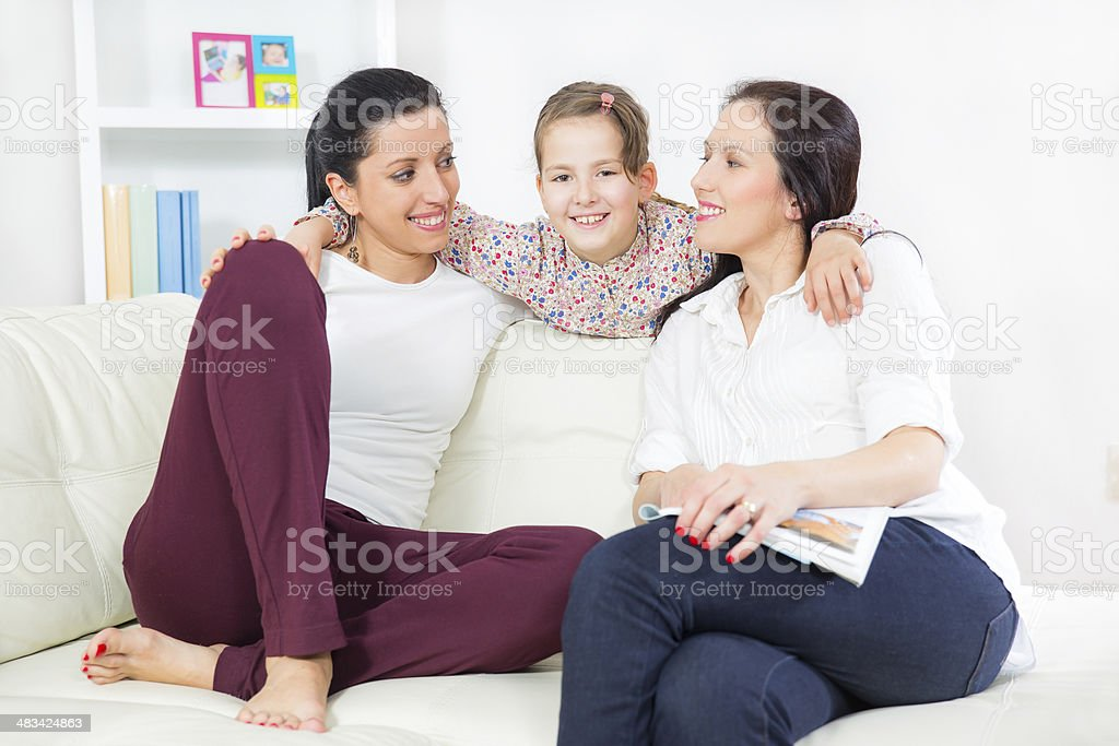 Girl with her mother and aunt stock photo