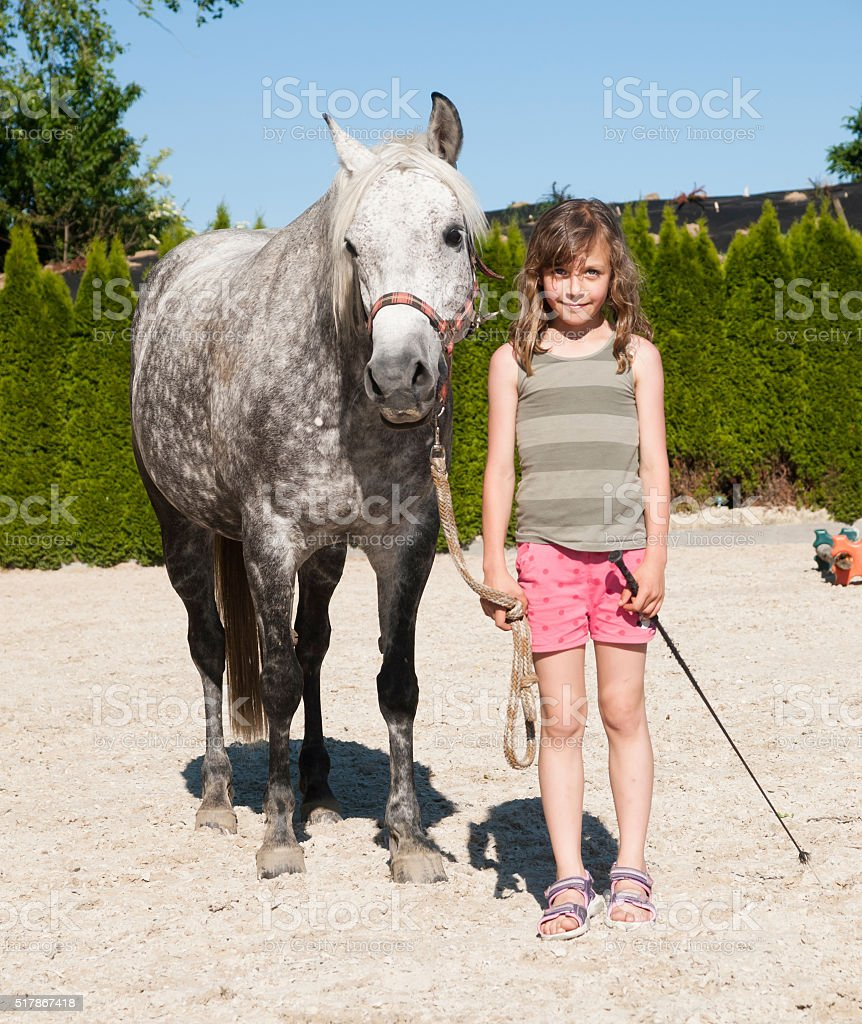 Girl with her pony stock photo