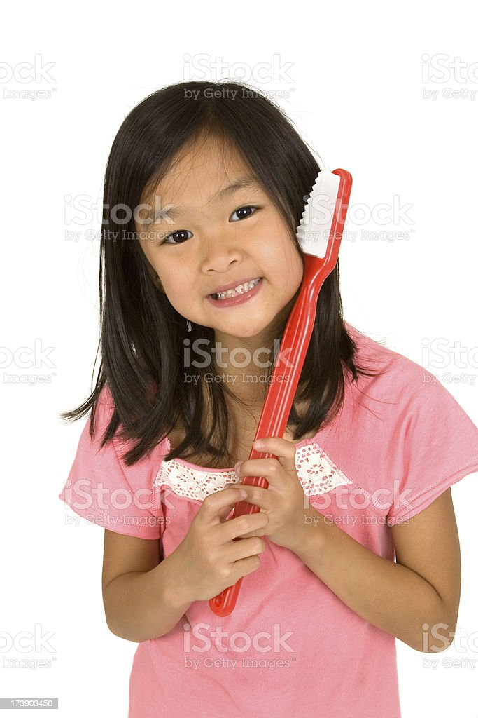 Girl with her toothbrush royalty-free stock photo