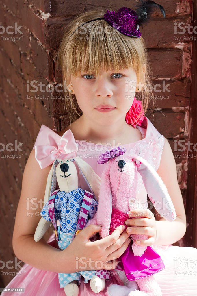 Girl with homemade toys stock photo