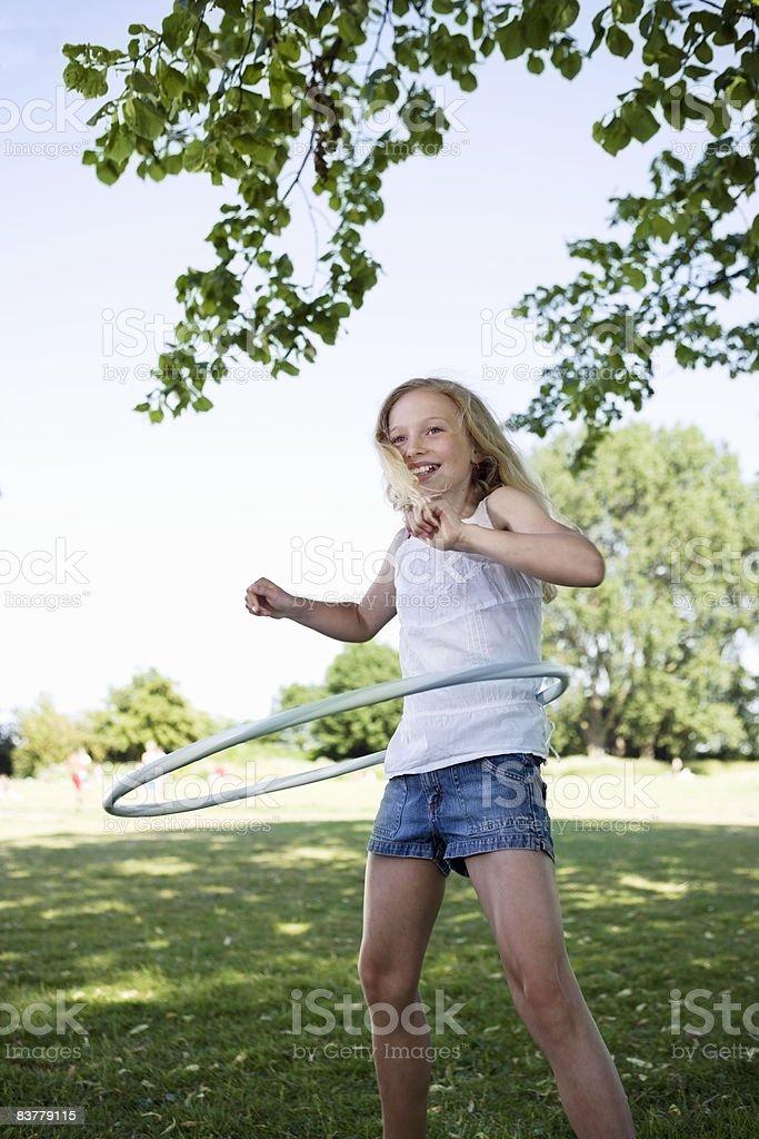 Girl with hula-hoop royalty-free stock photo