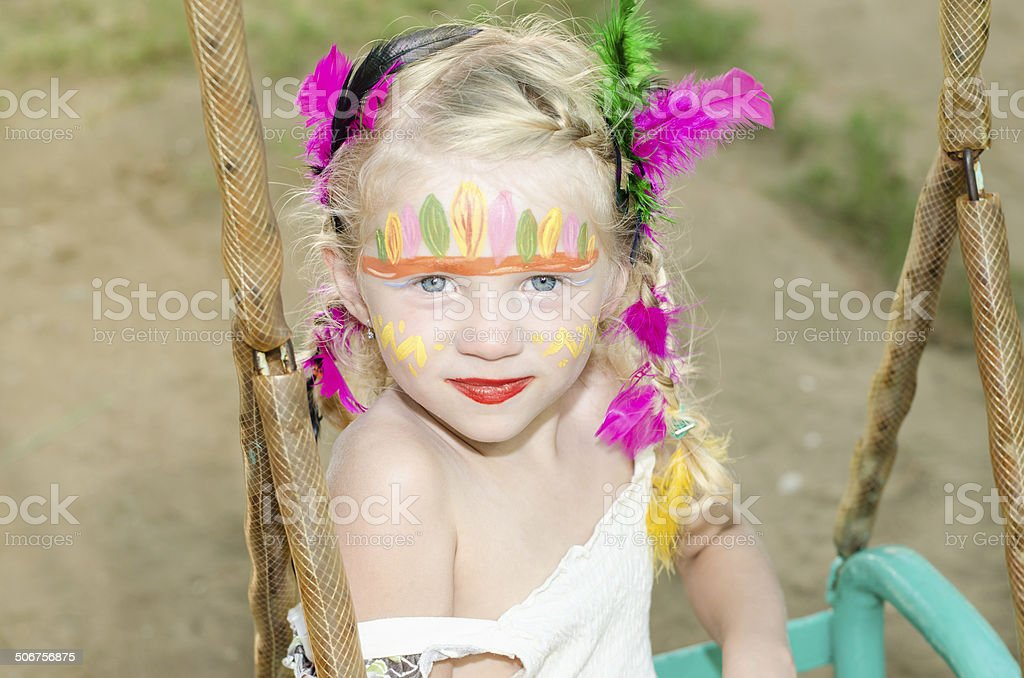 girl with indian face painting stock photo