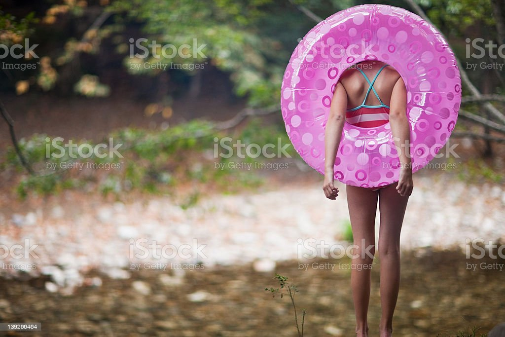 Girl with inflatable ring stock photo