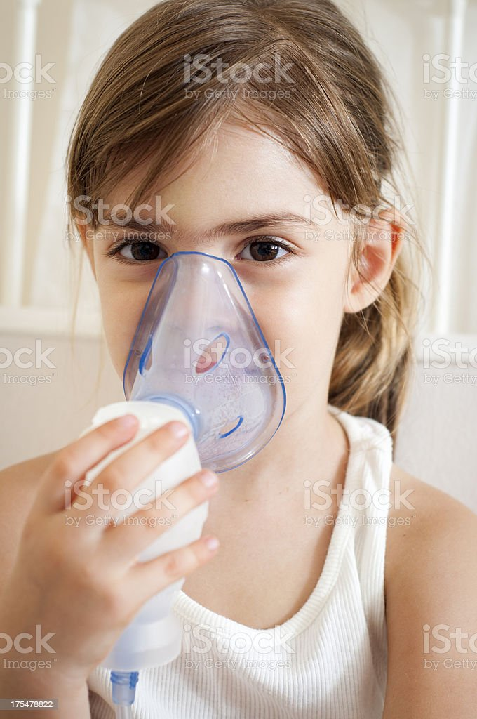 Girl with inhalation mask royalty-free stock photo