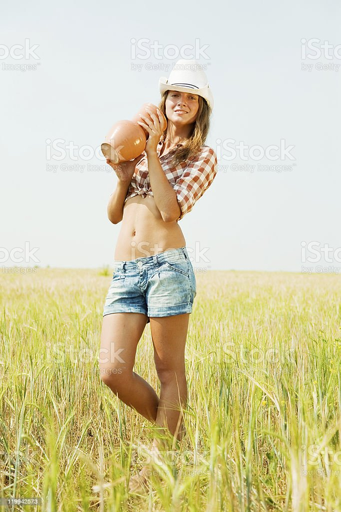girl  with jug at cereals field royalty-free stock photo