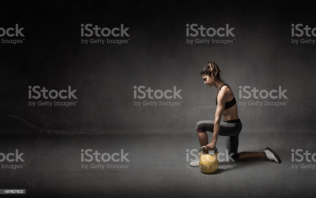 girl with kettlebell on hand stock photo